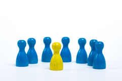 Team meeting. Board game figures in front of white background - concept of a team meeting Stock Photography