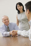Team member being congratulated by managers. royalty free stock images