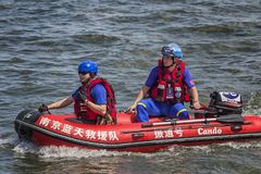 Team members of the Blue Sky Rescue Team to ensure the safety of the dragon boat race. In June 2018, the Dragon Boat Festival in Nanjing, China, was held in the stock photos