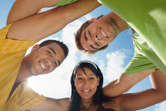 Team of men and woman embracing and smiling Royalty Free Stock Image
