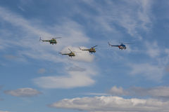 Team of MI-2 Helicopters Performing Elements in Air In Front of Spectators Stock Image