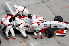Team Monaco mechanics pushing car back Stock Photography