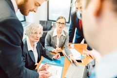 Team of motivated business people driving a project forward stock images
