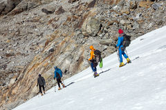 Team of Mountain Climbers carefully stepping down on Glacier Royalty Free Stock Photography