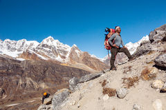 Team of Mountain Climbers led by Nepalese Sherpa Guide. International Team of Mountain Climbers ascending Himalaya Summit led by iconic Nepalese Sherpa Guide Stock Images
