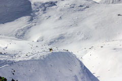 Team of mountaineers going toward summit with snow and wind stock image