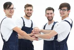 Team of movers joining hands. Royalty Free Stock Photography