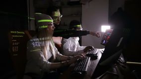 Team of multiethnic IT professionals working with computers in dark, hacking computer system. stock video
