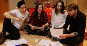 Team of musician composing tune in studio. Team of musician composing tune in recording studio stock footage