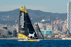 Team Neutrogena and Team Hugo Boss. Boat and Barcelona City Background. Barcelona World Race Royalty Free Stock Image