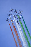 Team of nine aerobatic aircrafts. Aerobatic team of the Italian Air Force Frecce Tricolori (Three-coloured Arrows) on aircraft Aermacchi MB-339-A/PAN in flight Stock Image