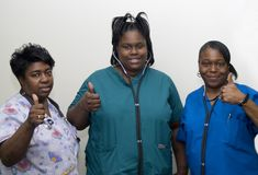 Team of nurses. Nurses at the hospital working together, showing their thumb up Royalty Free Stock Image