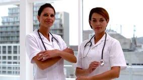 Team of nurses smiling at camera stock footage