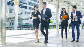 Free Team Of Business People Smart Man And Woman Walk In Rush Hour Stock Photo - 100508910