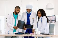 Free Team Of Young African Doctors Discussing Radiology Images Of Patients In The Clinic. Modern Diagnostic Centre. Medicine Stock Images - 160942914