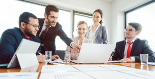 Team of office workers discussing business development royalty free stock image