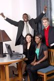 Team with one member arms out Stock Image