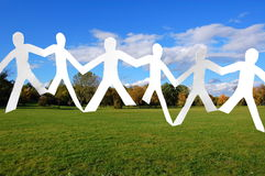 Team of paper people in the park Stock Photography
