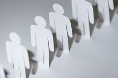 Team of papermen standing in a row Stock Photography