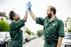 Team of paramedics doing a high five royalty free stock photography