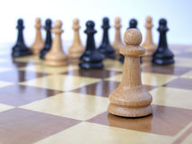 Team of pawns with leader. Metaphor of a business team with leader royalty free stock photos