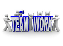Team of People Build Word Teamwork. A team of people work together to build the word Teamwork Royalty Free Stock Images