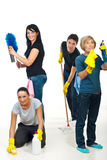 Team of people cleaning your house. Happy team of four smiling people cleaning your house,each person doing something different royalty free stock images