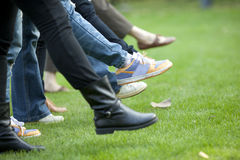 Team people walking on the grass Stock Photography