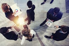 Team of business person works together on company statistics. Shooted from above. Concept of teamwork and partnership royalty free stock photo