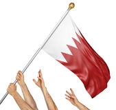 Team of peoples hands raising the Bahrain national flag. 3D rendering isolated on white background Royalty Free Stock Photography