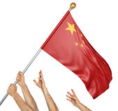 Team of peoples hands raising the China national flag, 3D rendering isolated on white background. Group of peoples hands raising the national flag of China into Stock Photos
