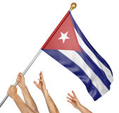 Team of peoples hands raising the Cuba national flag. 3D rendering isolated on a white background Stock Image