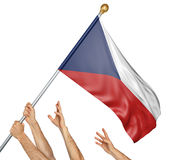 Team of peoples hands raising the Czech Republic national flag. 3D rendering isolated on white background Stock Photography
