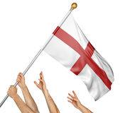 Team of peoples hands raising the England national flag Royalty Free Stock Photos