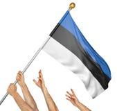 Team of peoples hands raising the Estonia national flag Stock Photos