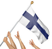 Team of peoples hands raising the Finland national flag. Team of peoples hands raising the Finland national flag, 3D rendering isolated on white background Royalty Free Stock Image
