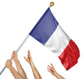 Team of peoples hands raising the France national flag. 3D rendering isolated on white background Stock Image