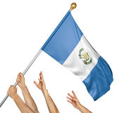 Team of peoples hands raising the Guatemala national flag. 3D rendering isolated on white background Stock Images