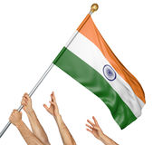 Team of peoples hands raising the India national flag stock photo