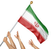 Team of peoples hands raising the Iran national flag. 3D rendering isolated on white background Royalty Free Stock Images