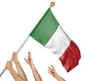 Team of peoples hands raising the Italy national flag stock photos