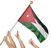 Team of peoples hands raising the Jordan national flag. 3D rendering isolated on white background Royalty Free Stock Image