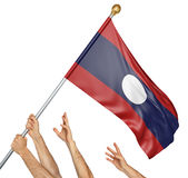 Team of peoples hands raising the Laos national flag. 3D rendering isolated on white background Royalty Free Stock Photography