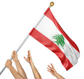 Team of peoples hands raising the Lebanon national flag. 3D rendering isolated on white background Royalty Free Stock Photo