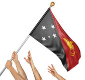 Team of peoples hands raising the Papua New Guinea national flag. 3D rendering isolated on white background Stock Images