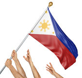 Team of peoples hands raising the Philippines national flag. 3D rendering isolated on white background Stock Image