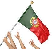 Team of peoples hands raising the Portugal national flag. 3D rendering isolated on white background Stock Photos
