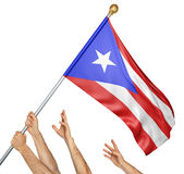 Team of peoples hands raising the Puerto Rico national flag. 3D rendering isolated on white background Stock Photos