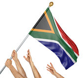 Team of peoples hands raising the South Africa national flag. 3D rendering isolated on white background Royalty Free Stock Photo