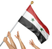 Team of peoples hands raising the Syria national flag. 3D rendering isolated on white background Stock Images